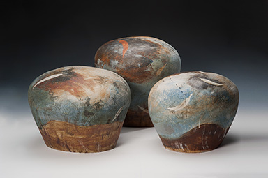 3 mound-shaped ceramic sculptural forms with landscape inspired surface decoration